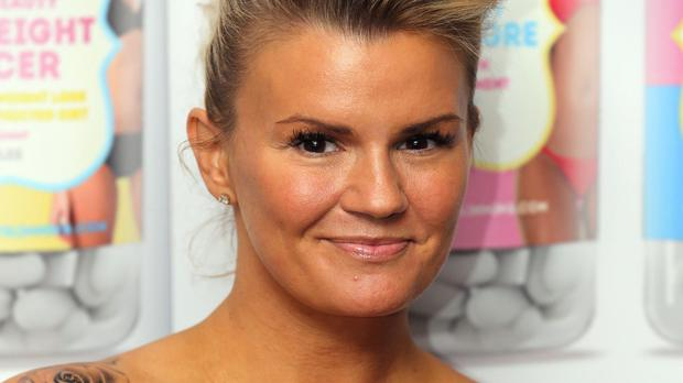 Kerry Katona's estranged husband has been charged with assaulting her and possessing an illegal weapon