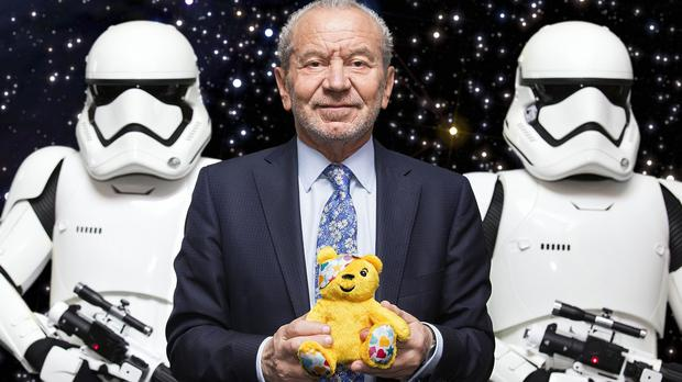Lord Sugar with two Stormtroopers (BBC/PA)