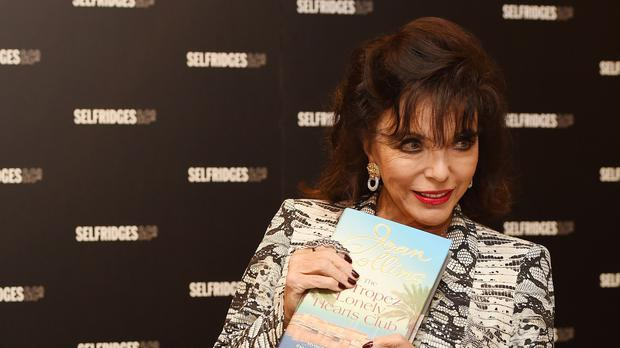 Dame Joan Collins signs copies of her new book at Selfridges in London.