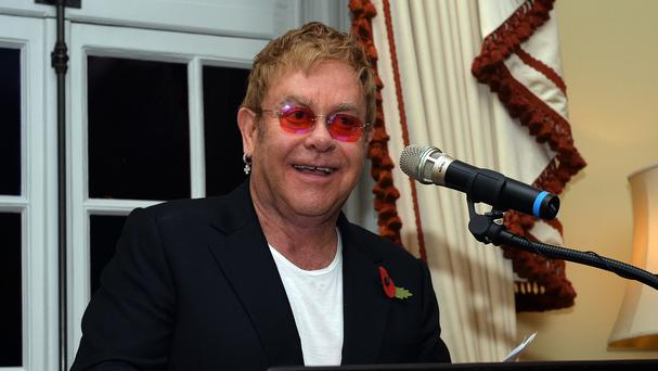 Sir Elton John gives a speech at Winfield House in London to promote a new HIV/Aids partnership with the US government
