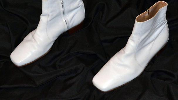 A pair of white Verde boots worn by Elvis Presley during his 1968 performance of If I Can Dream