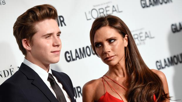 Victoria Beckham and her son Brooklyn attend the 25th Annual Glamour Women of the Year Awards in New York (AP)