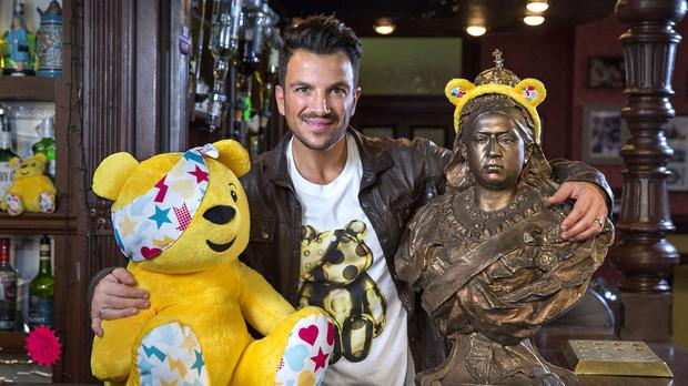 Peter Andre behind the bar at The Queen Vic (BBC/PA)