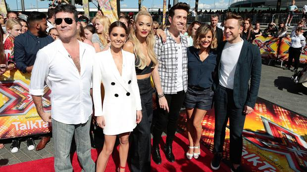 The X Factor pulled in a combined average audience of 8.94 million on October 4