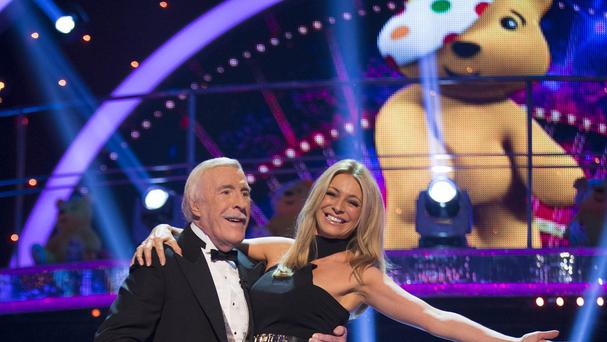 Strictly Come Dancing hosts Bruce Forsyth and Tess Daly taking part in a special Call The Midwife edition of the show for BBC Children In Need. (BBC/PA)