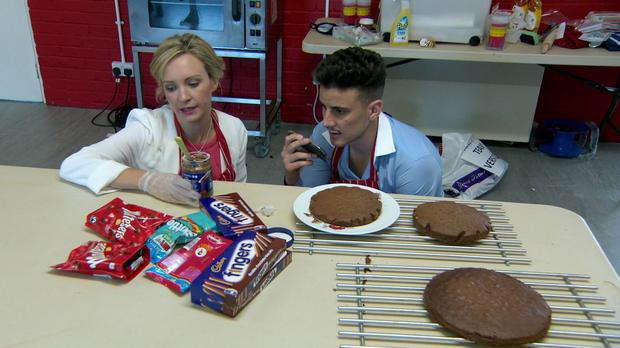 Charleine Wain and Joseph Valente baking a chocolate cake as they take part in the latest challenge on The Apprentice (BBC/PA)