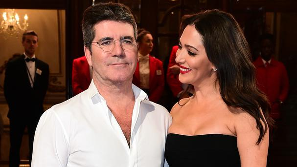 Simon Cowell and girlfriend Lauren Silverman were reportedly burgled as they and their son slept at their west London home