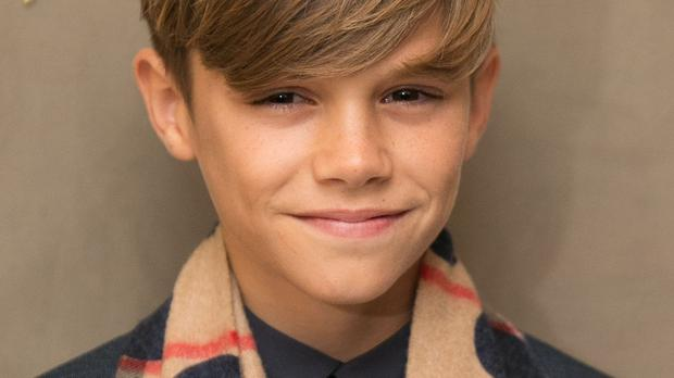 Romeo Beckham is a fashion model for Burberry