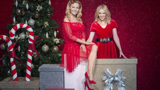 Kylie Minogue poses beside her new wax figure at Madame Tussauds in London