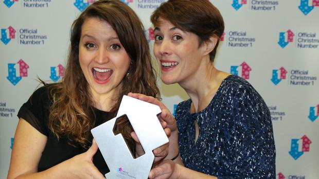 NHS Choir members Katie Rogerson and Caroline Smith with their Official Christmas Number 1 Award (officialcharts.com/PA)