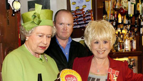 The Queen pictured with Barbara Windsor during a 2001 visit to the EastEnders set at Elstree Studios