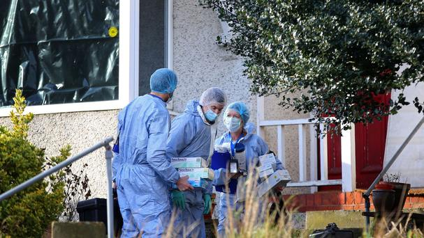 Police forensic officers at the family's house in Erith, Kent