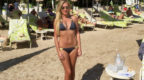 Claudine Keane poses on a beach in Dubai. Twitter.