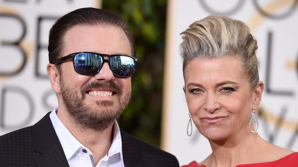 Ricky Gervais Jane Fallon arriving for the Golden Globes, which the British comedian is hosting (AP)