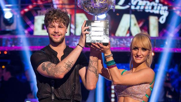 Aliona Vilani and Jay McGuiness lift the Strictly glitterball trophy