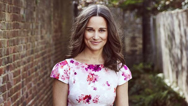 Pippa Middleton wearing a dress she designed, which will join other unique items to be auctioned off. (British Heart Foundation / PA Wire)