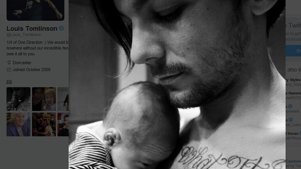 A Tweet showing how One Direction star Louis Tomlinson shared the first picture of his newborn son Freddie online.