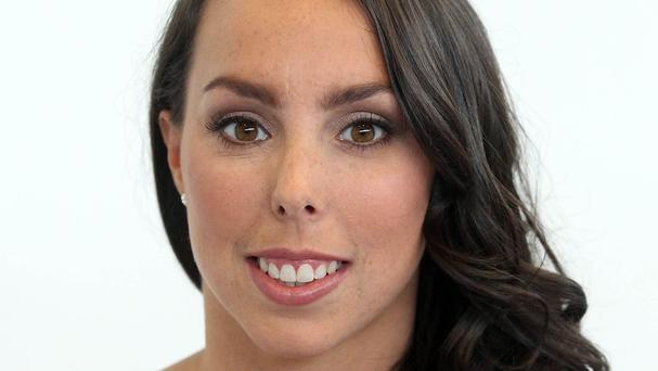 Beth Tweddle tweeted a photograph of herself wearing a neck brace and standing upright