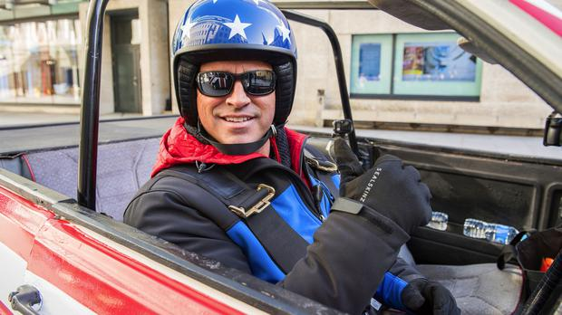 Matt LeBlanc taking part in the first challenge for Top Gear with Chris Evans, which is a UK v USA race from London to Blackpool in Reliant Rialtos, emblazoned with their respective country's flags.