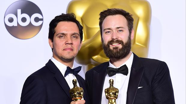 Producer Shan Christopher Ogilvie (left) and director Ben Cleary with their Oscar for Best Live Action Short Film for Stutterer.