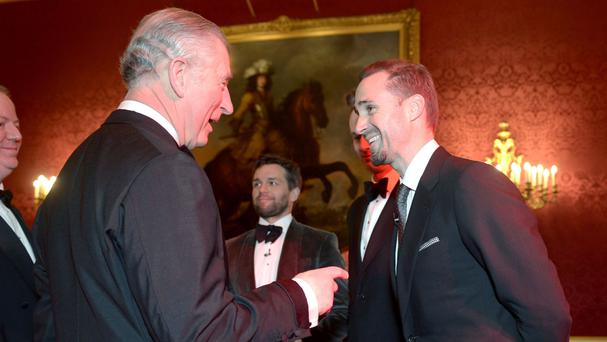 The Prince of Wales meets Joseph Fiennes during the gala concert marking the 10th anniversary of the Children and the Arts charity