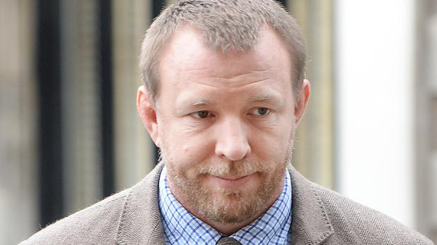 Guy Ritchie arrives at the Royal Courts of Justice in central London to attend a hearing relating to a dispute between against himself and his former wife Madonna over the future of their son Rocco.