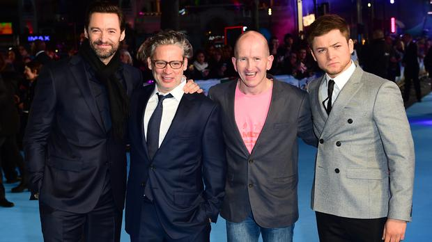 From left to right, Hugh Jackman, Dexter Fletcher, Eddie