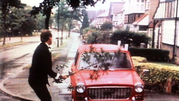 Basil Fawlty bashing his car with a branch