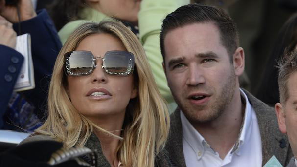 The glamour model, pictured with husband Kieran Hayler at the Cheltenham Festival, named and shamed internet commentators who posted messages about her son Harvey