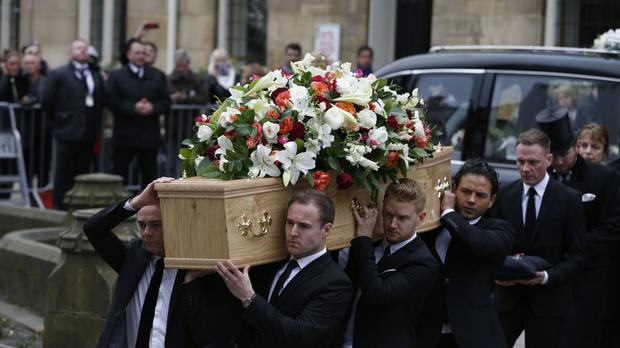 Coronation Street cast members, from left to right, Jack P Shepherd, Alan Halsall, Mikey North and Ryan Thomas carry the coffin of creator and writer Tony Warren into Manchester Cathedral for his funeral