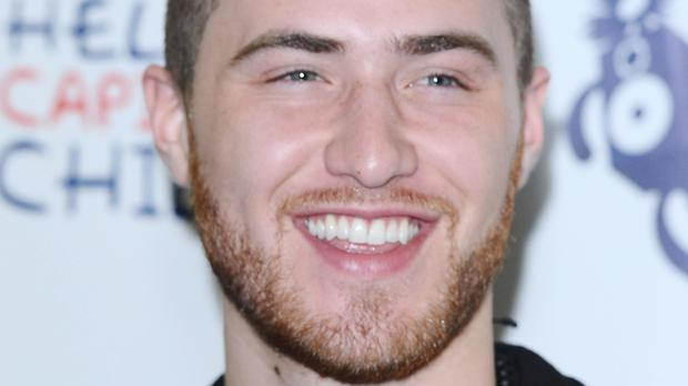 Mike Posner is top of the singles chart
