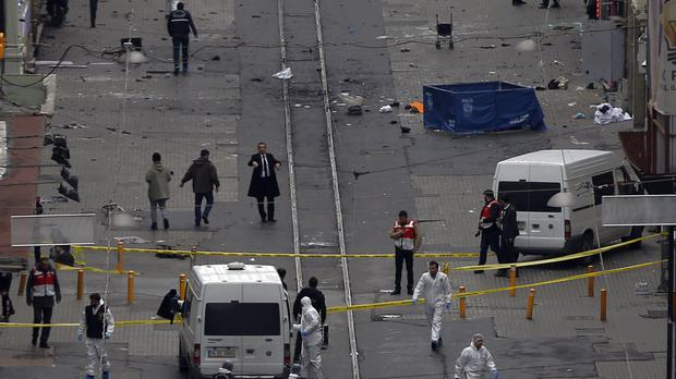 Emergency services at the scene of the explosion (AP)