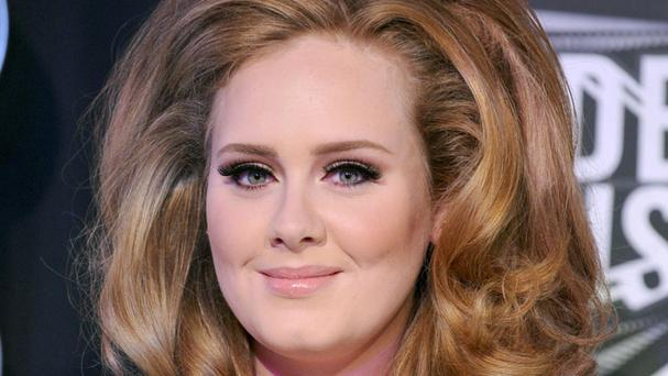 A hacker shared a haul of Adele's photos online, according to the Sun On Sunday