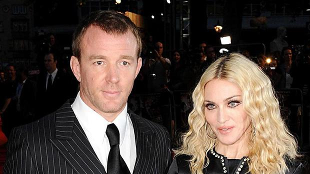 Guy Ritchie and Madonna were embroiled in separate litigation in England and New York