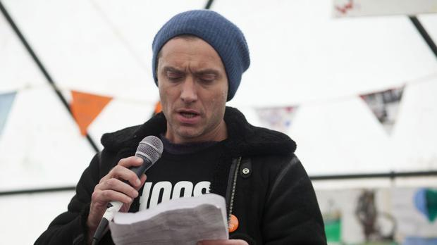 Jude Law was among the famous faces who visited the Jungle camp in Calais last month to perform to refugees (Help Refugees)