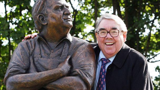 Ronnie poses beside a statue tribute to his long time comedy partner