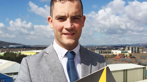 Former Big Brother contestant Glyn Wise with a copy of his party's manifesto at Cardiff and Vale College