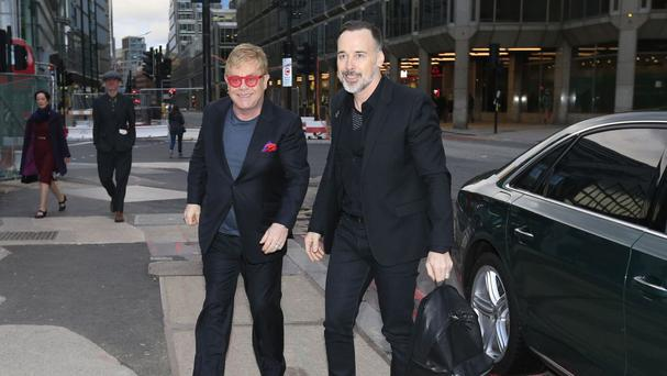Sir Elton John and husband David Furnish arrive at the Victoria Palace Theatre in central London for a special celebration as the musical Billy Elliot closes