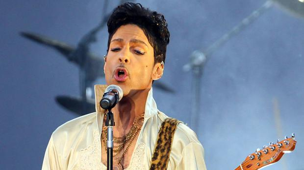 Prince seen performing at the Hop Farm Festival in Kent - the superstar has been fighting flu for several weeks and became unwell on a plane