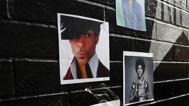 A photo of Prince is posted outside First Avenue, Minneapolis, as a memorial grows to the pop star (AP)