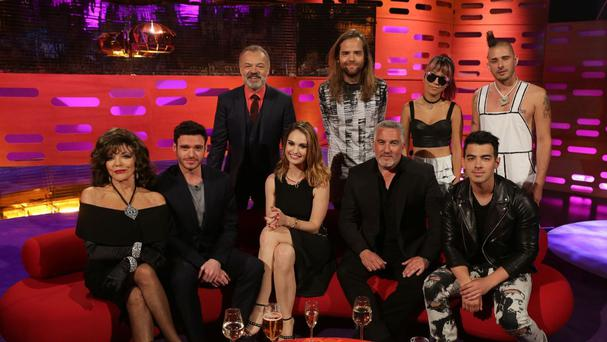 From left to right, Joan Collins, Richard Madden, Graham Norton, Lily James, Jack Lawless, Paul Hollywood, JinJoo Lee, Joe Jonas and Cole Whittle pose together after filming the Graham Norton Show (BBC/PA)