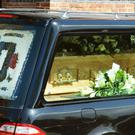 The coffin arrives for the funeral of David Gest at Golders Green Crematorium in north London