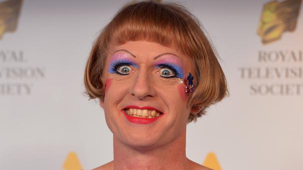 Transvestite artist Grayson Perry said emotionally inarticulate men are committing suicide over an obsession with Bear Grylls-style machismo and bulging muscles