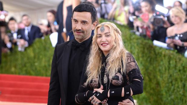 Riccardo Tisci with Madonna, who left little to the imagination as she arrived at the Met Gala in a lacy black dress. (Evan Agostini/Invision/AP)