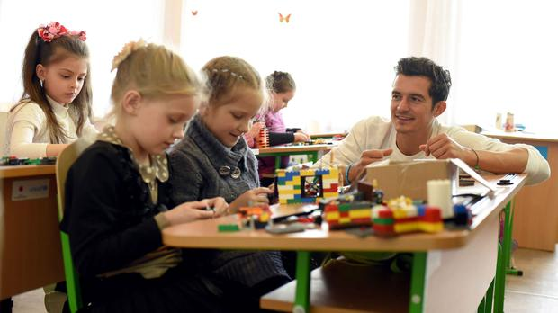 Orlando Bloom playing with pupils of a school in Slovyansk, as part of a visit to conflict-hit eastern Ukraine (Unicef/PA)