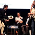 Steve Coogan, left, is presented with a cheesecake from former bake off winner Frances Quinn, right, during a screening of his new one-off special Alan Partridge's Scissored Isle