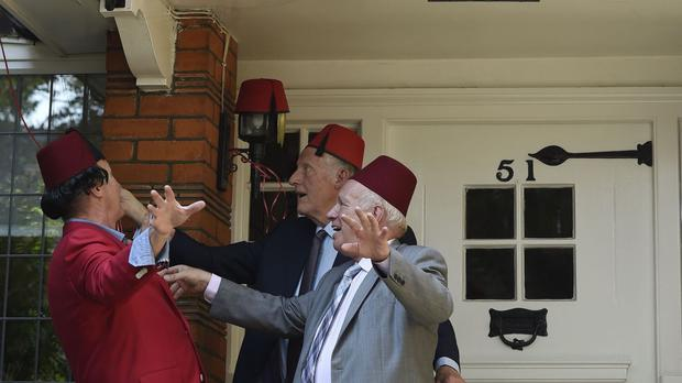 (left to right) Clive St. James Greenaway, Councillor John Todd and Greg Dyke unveil a Blue Plaque awarded by English Heritage at the former home in Chiswick of comedian Tommy Cooper.