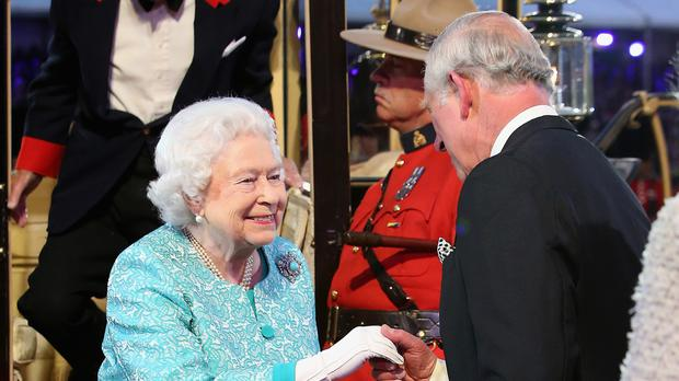 The Queen is greeted by the Prince of Wales