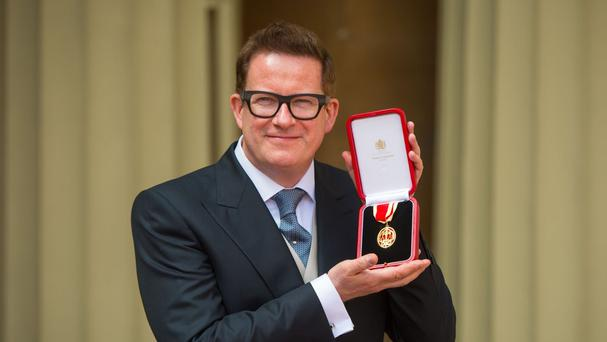 Choreographer Sir Matthew Bourne after receiving his Knighthood at an investiture ceremony at Buckingham Palace