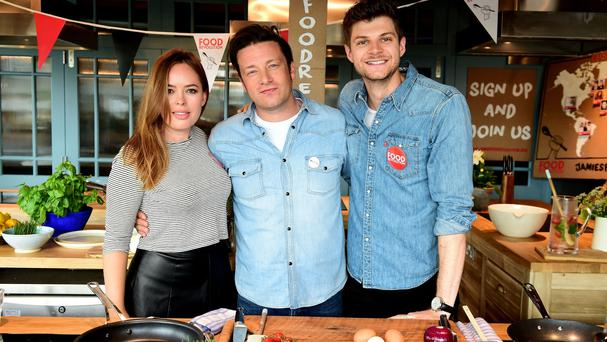 Jamie Oliver with Tanya Burr (left) and Jim Chapman (right) at his Cookery School in Westfield Shopping Centre